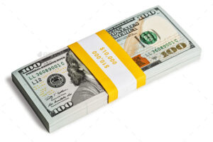 Creative business finance making money concept - bundle of 100 US dollars 2013 edition banknotes bills isolated on white